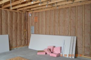 insulated walls with pieces of drywall