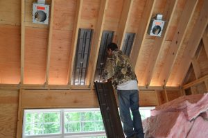 man placing insulation