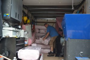 man moving insulation pieces
