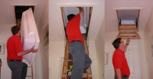 man placing attic insulator
